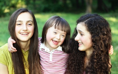 Happy little girl with sisters